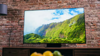 The Samsung QN90A displaying colorful 4K content in a living room setting
