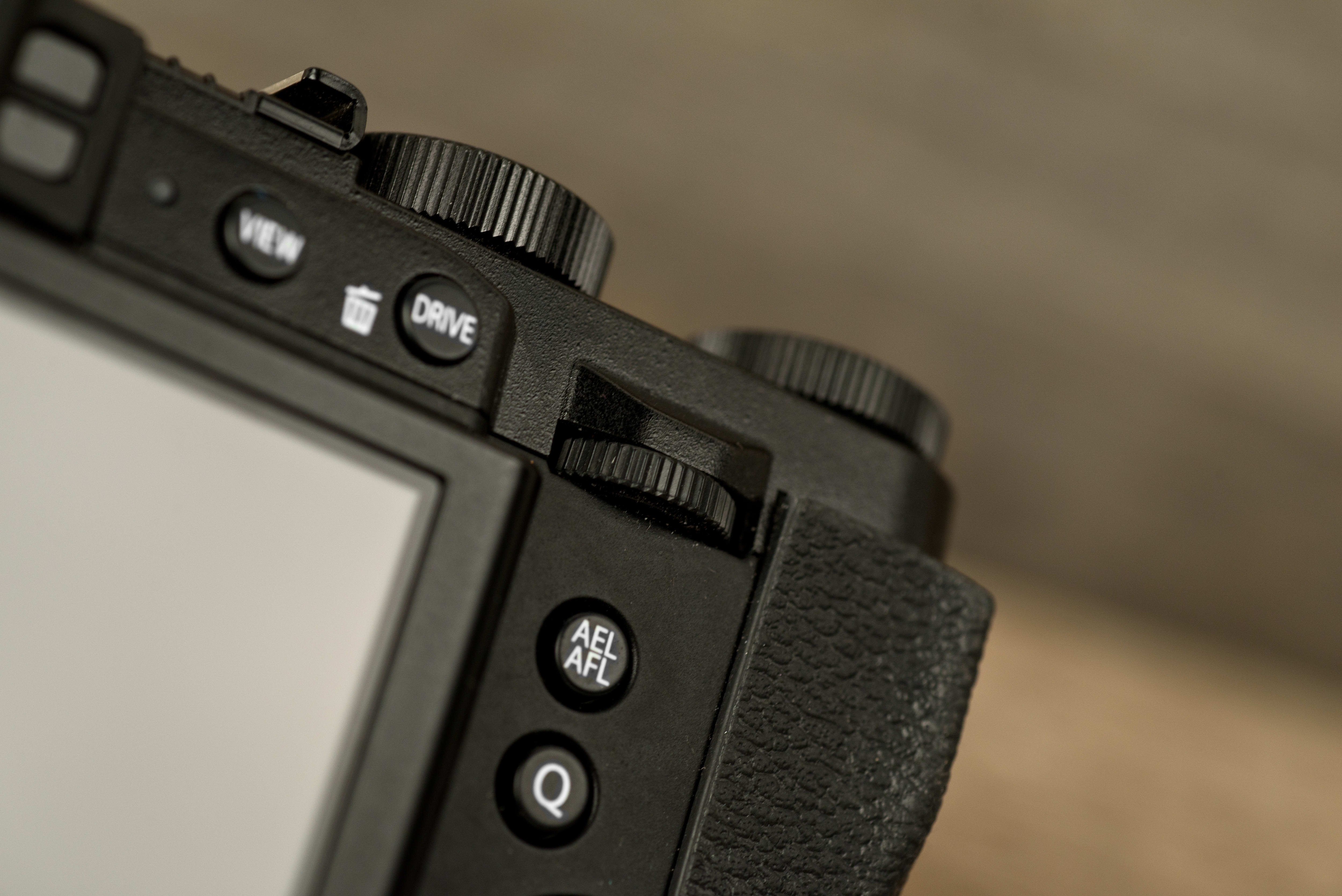 A photo of the Fujifilm X30's rear control dial.