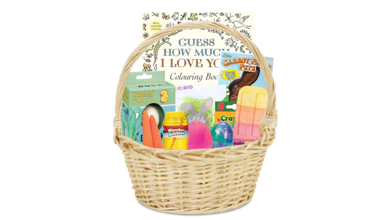 A cream wicker basket houses a coloring book, crayons, ice cream chalk, and edible grass candy.
