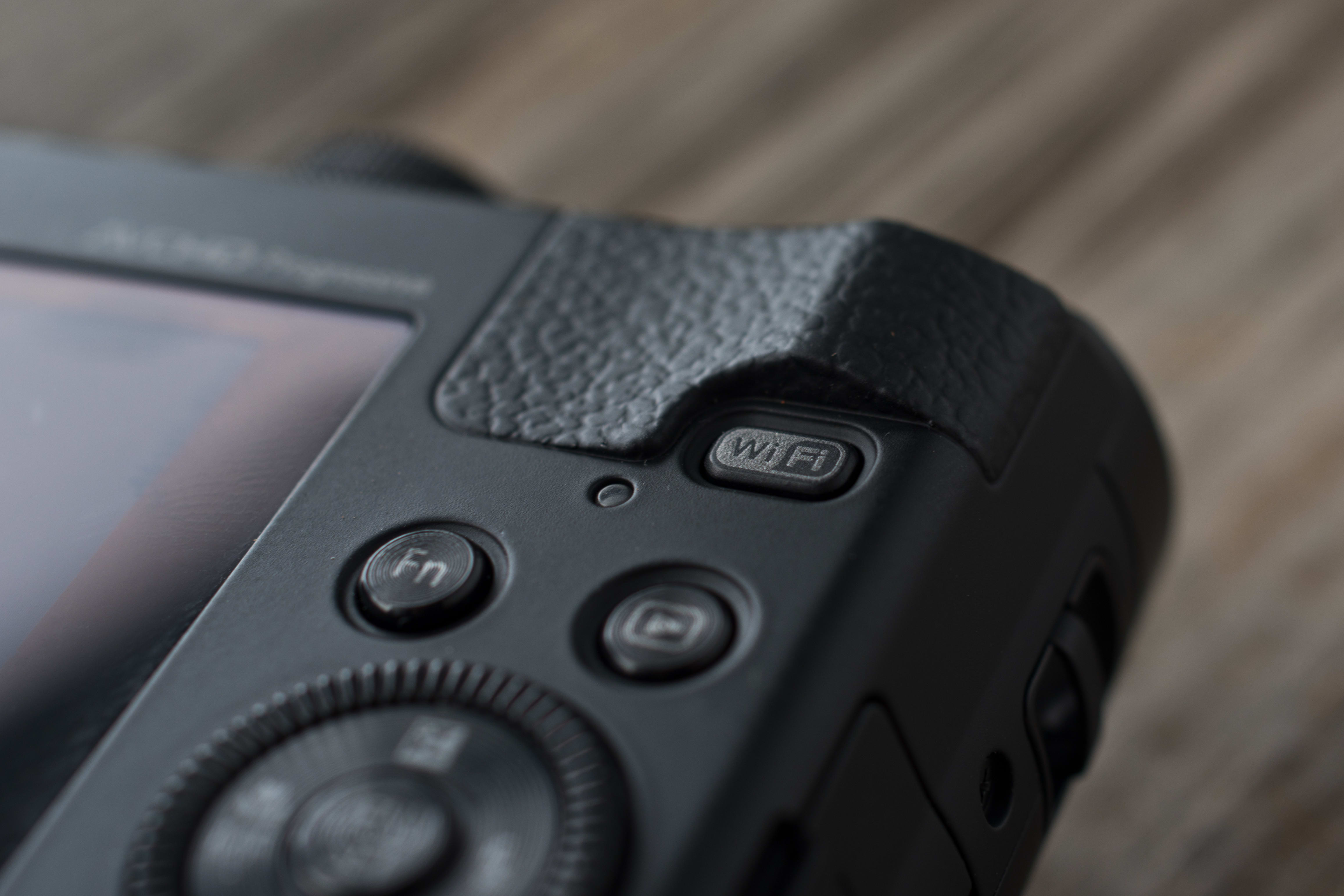 A picture of the Panasonic Lumix ZS40's WiFi button.