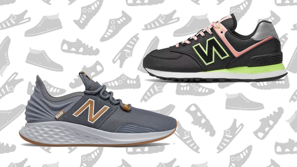 A pair of gray and black New Balance sneakers against a white and gray shoe background.