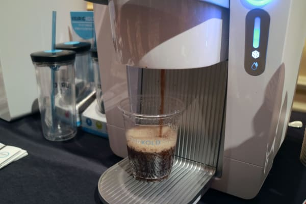 Keurig Kold pouring a cup of soda