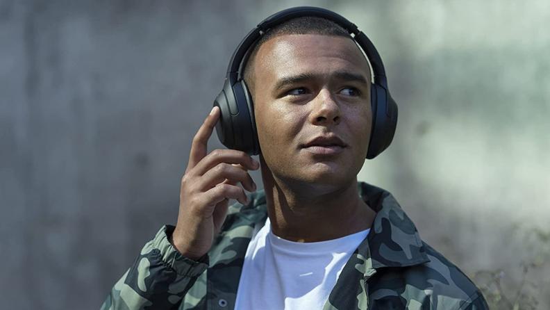 A person wears noise-canceling headphones.