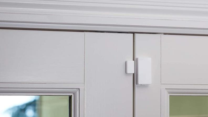 An Abode security sensor on an exterior door.