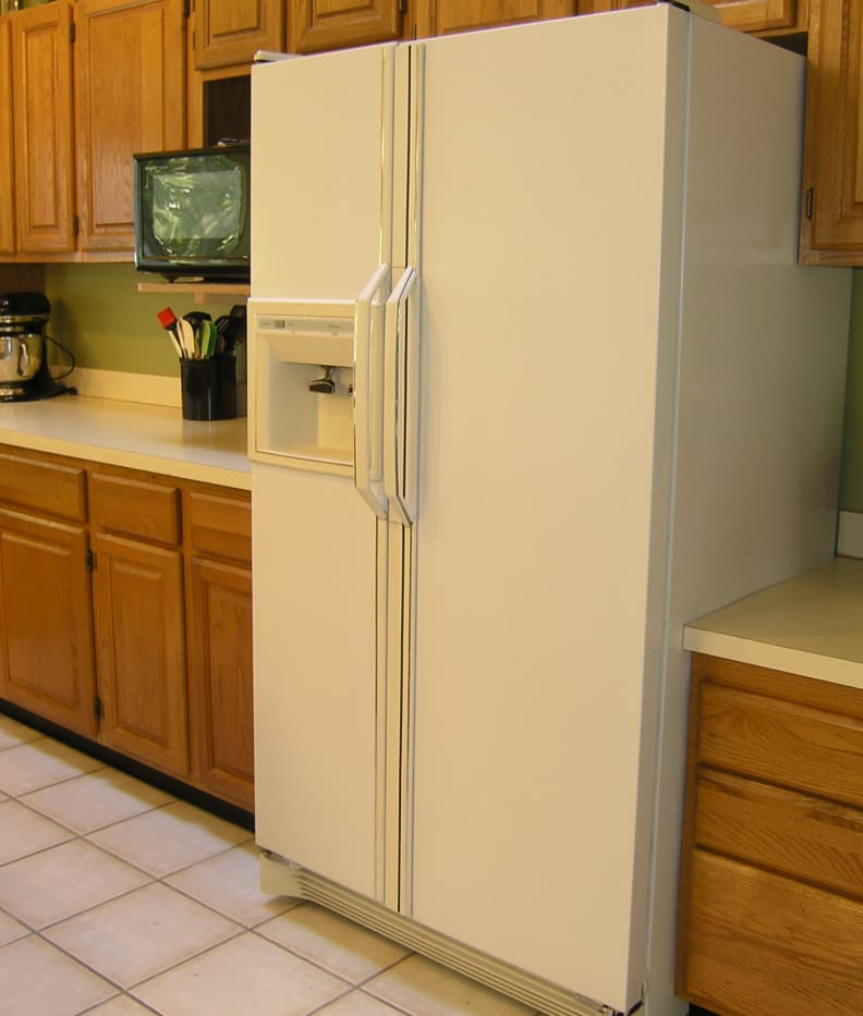 Larger fridges, like this white side-by-side, will require more time, effort, and paint...