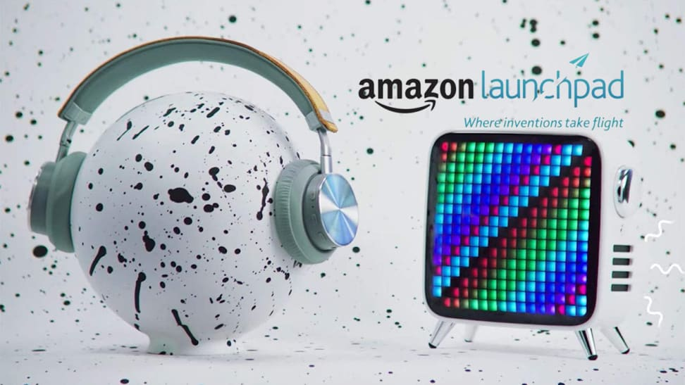 """grey background with tablet and headphones on speckled ball that reads """"Amazon launchpad"""""""