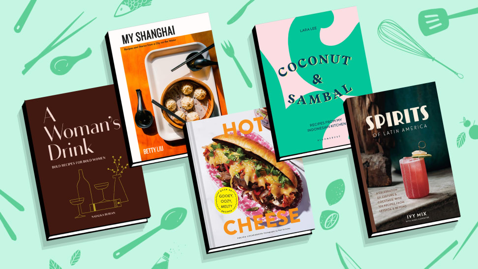 Five cookbooks on a mint colored, patterned background