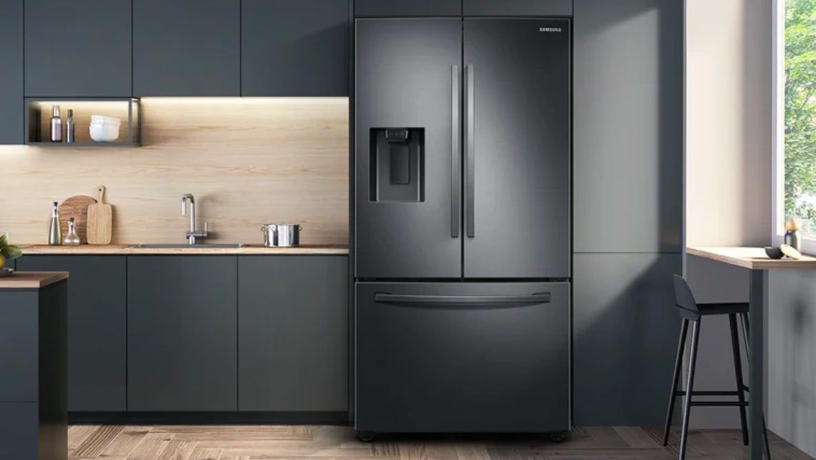 An image of the front of the Samsung RF27T5201SG French door refrigerator in a modern kitchen.