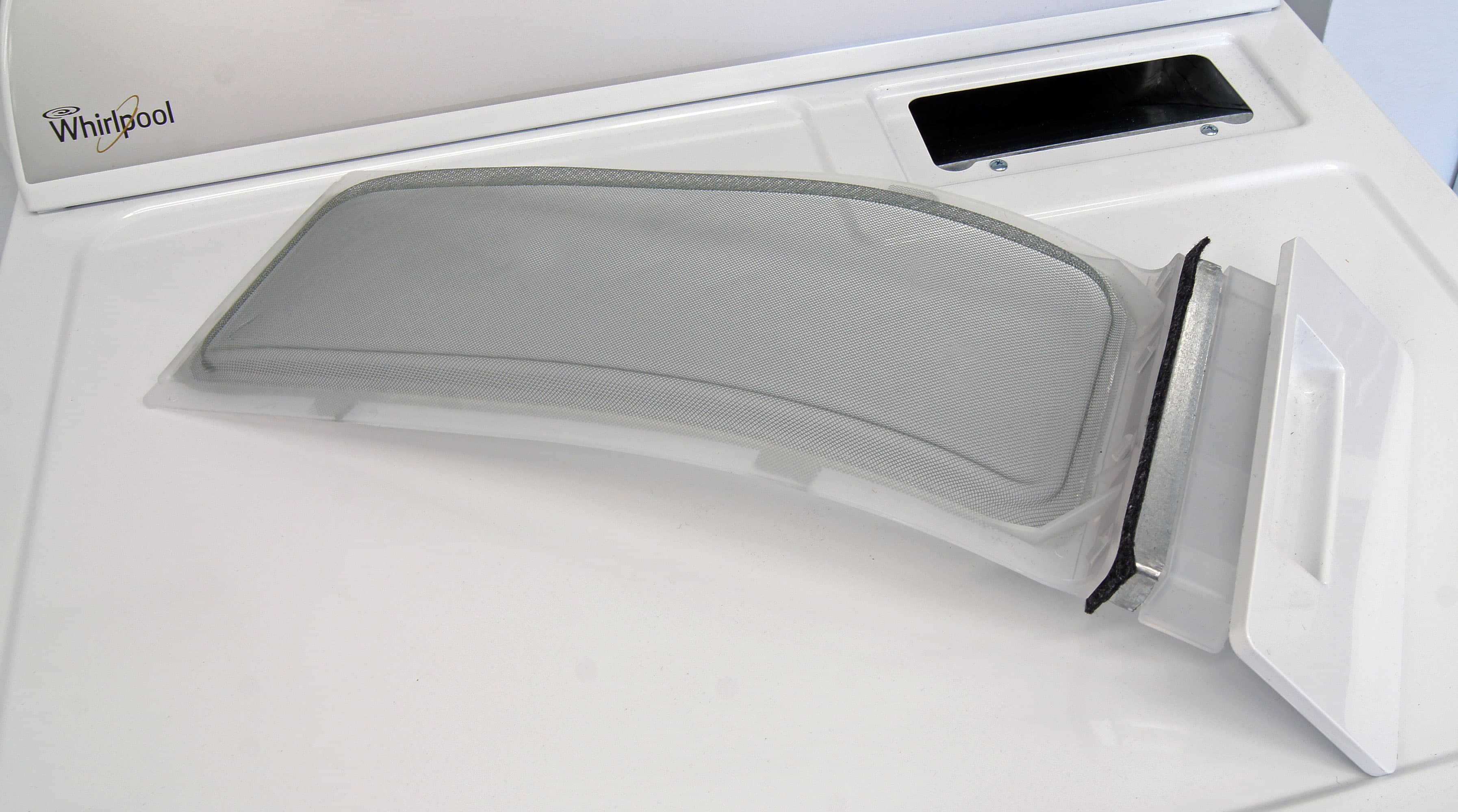 Pull-out lint traps like the one on the Whirlpool WED4915EW are easy to clean, but can spread lint around your laundry room if the trash bin isn't nearby.