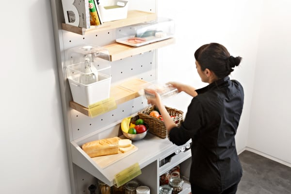 However, the wooden shelves actually contain induction technology for cooling food, creating an