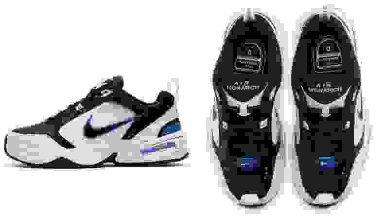 Pair of white Nike Air Monarch IV shoes with navy accents.