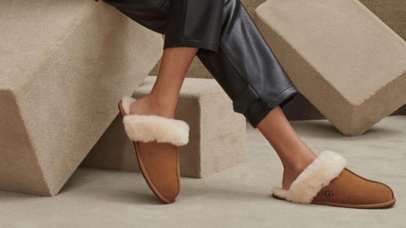 A person wearing UGG Women's Scuffette II slippers