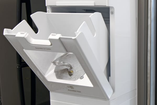 You don't even need to remove the Kenmore 51783's ice bucket for a scoop of ice—just tip it forward.