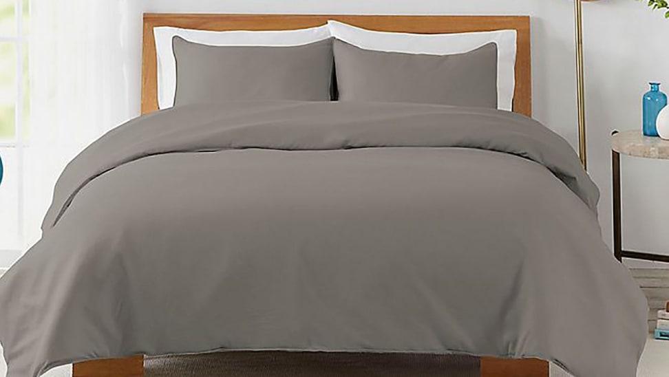 Bed with brown comforter set in bedroom.