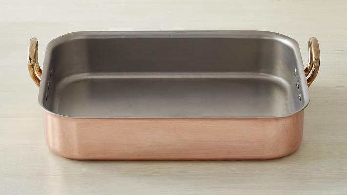 A copper roasting pan with handles.