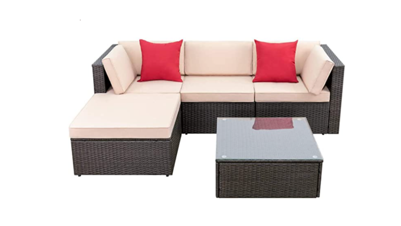 An outdoor sofa with pink pillows against a white background.