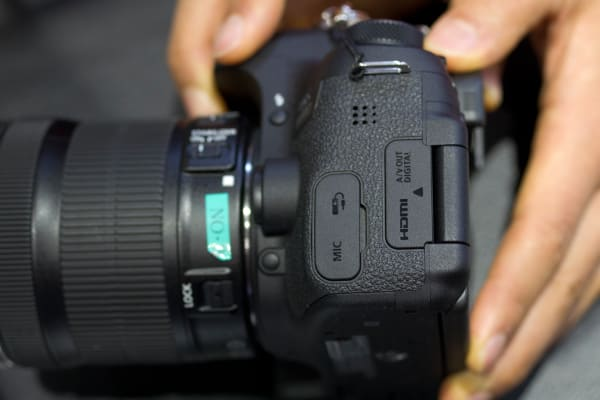 The camera's ports include a microphone jack, HDMI output, and A/V digital out, but not a headphone jack.