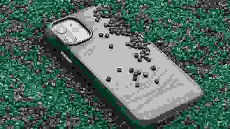 A green phone case surrounded by beads.