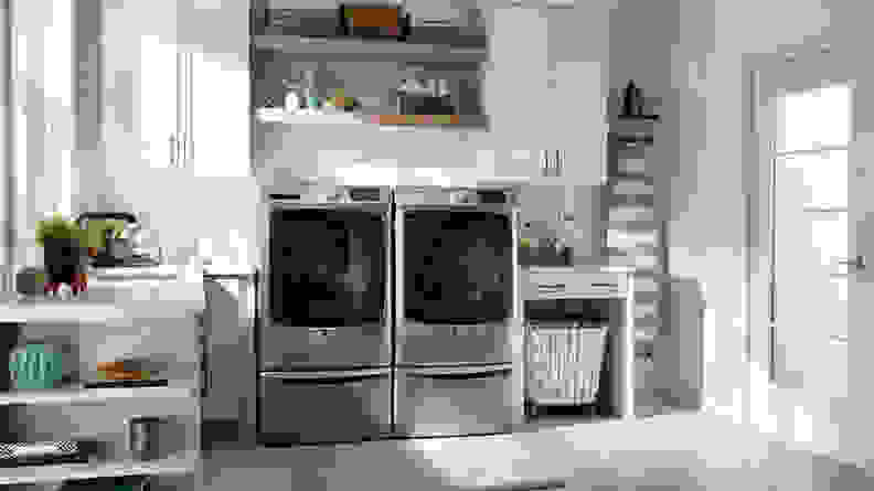 The Maytag MHW6630HC beside a Maytag dryer in a laundry room.