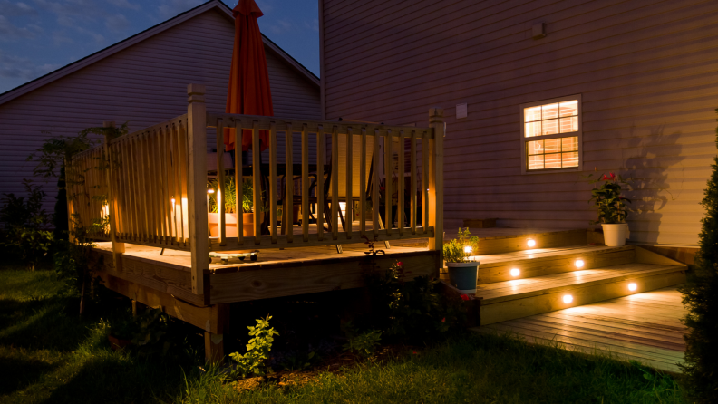 Patio deck outdoors lit up at night