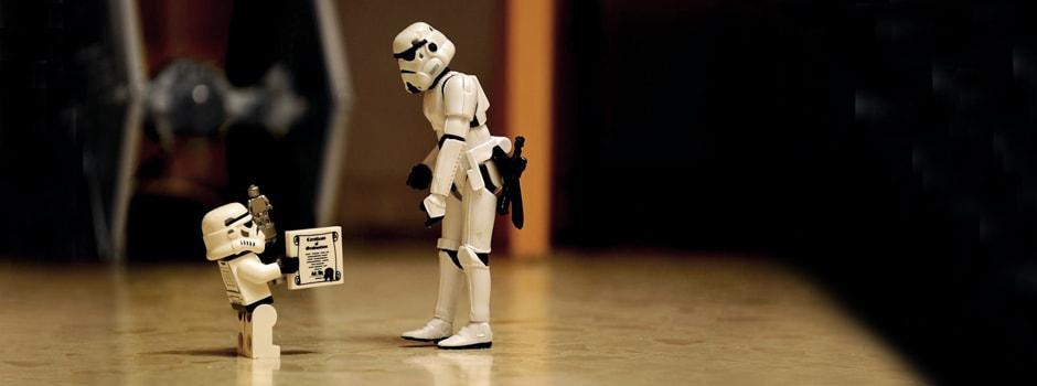 Storm Trooper kid is giving Storm Trooper dad the droid he has always been looking for.