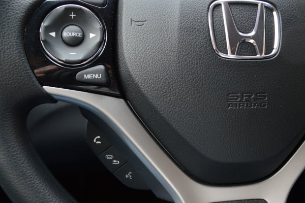 Press the voice recognition button for Siri Eyes Free on the 2014 Honda Civic.