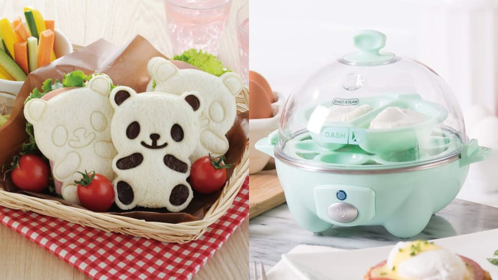 On the left, three panda-shaped sandwiches crowd a wicker bassket with some cherry tomatoes and other vegetables. On the right, a blue Dash egg cooker is on a kitchen counter.