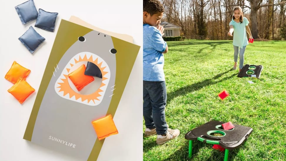 On one side is a shark-themed cornhole board with blue and yellow beanbags. On the other side two children play a game of cornhole on a collapsible set.