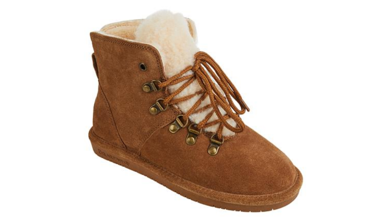 An image of a single lace-up suede boot in warm brown with a fluffy sherpa interior.