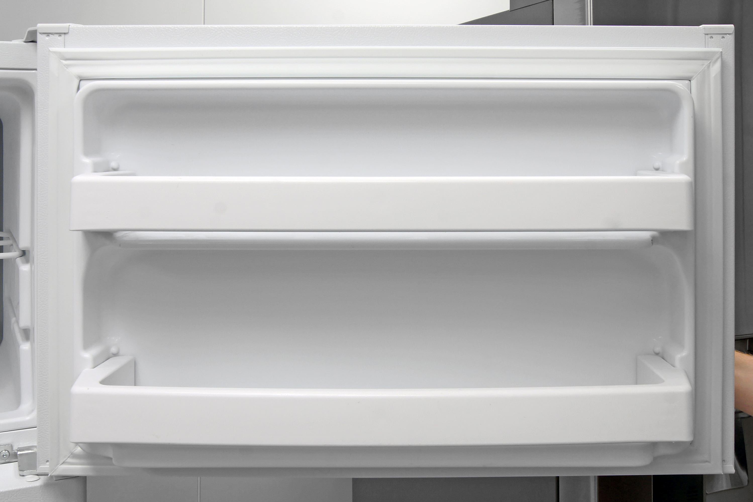 Fixed shelves on the GE GTS16DTHWW's freezer door add supplemental smaller item storage.