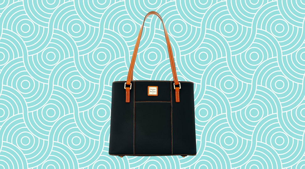 A leather Dooney & Bourke bag on a vibrant teal background.
