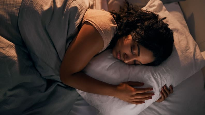 a woman sleeps in bed