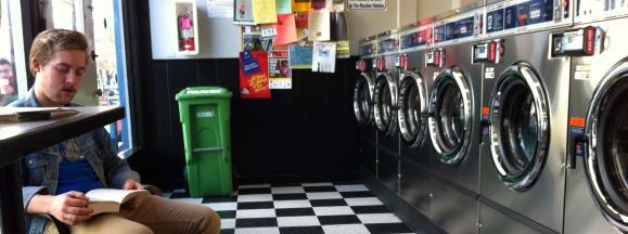 Man at laundromat laundry hero flickr dlytle