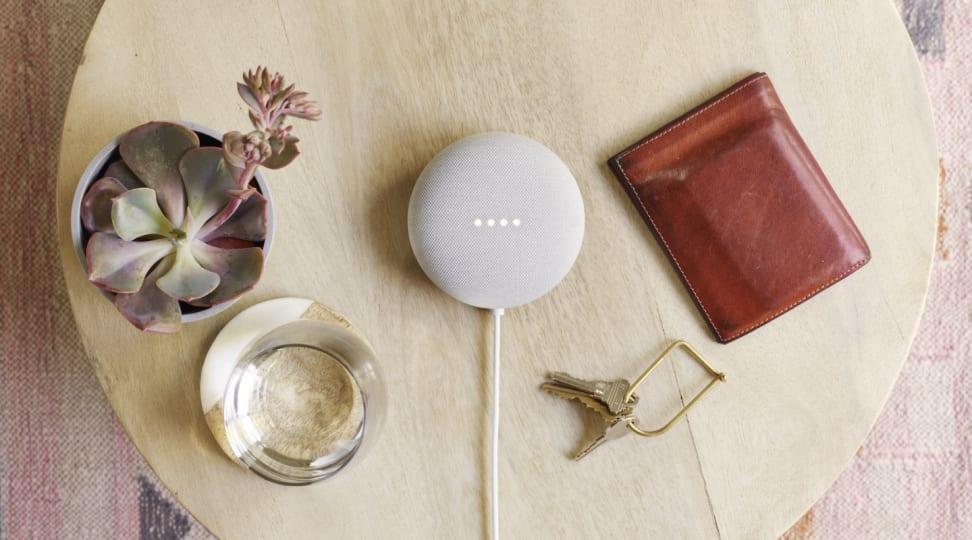 Google's Nest Mini sits on a table.