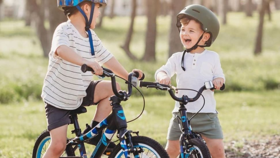 Two children laugh as they sit on their Guardian Kids Bikes