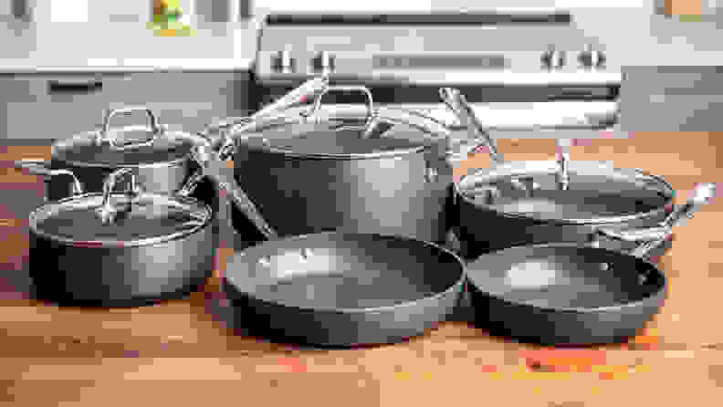All-Clad HA1 nonstick cookware set displayed on kitchen counter.