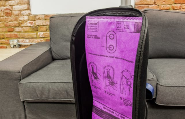 An Oreck upright vacuum with a large, replaceable bag.