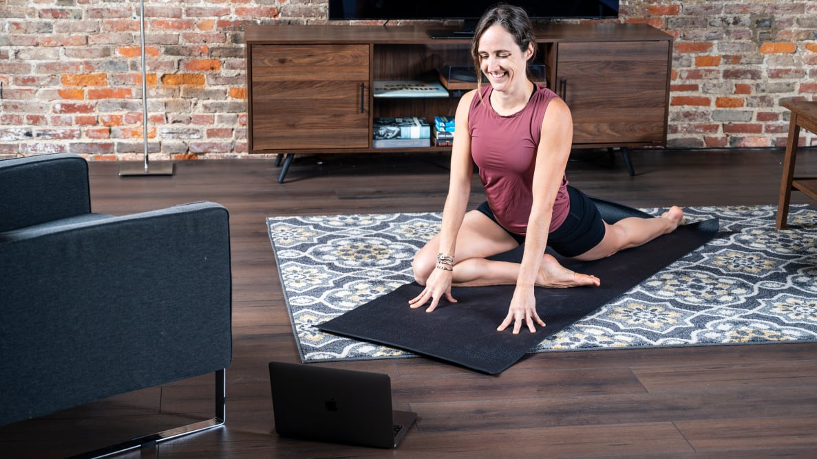 Woman practicing yoga at home.