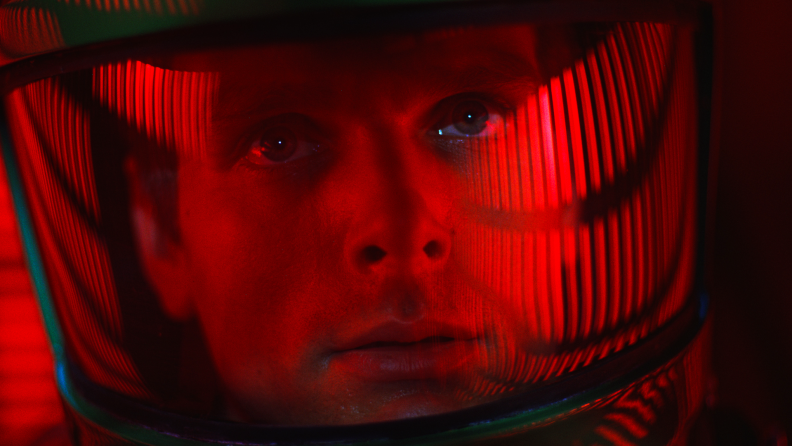 Keir Dullea stars as David Bowman (pictured in close-up wearing a spacesuit) in 2001: A Space Odyssey.