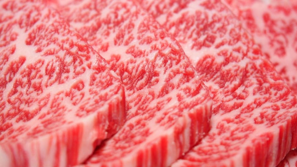 An extreme closeup photo of Japanese wagyu beef, known for its extreme marbling.