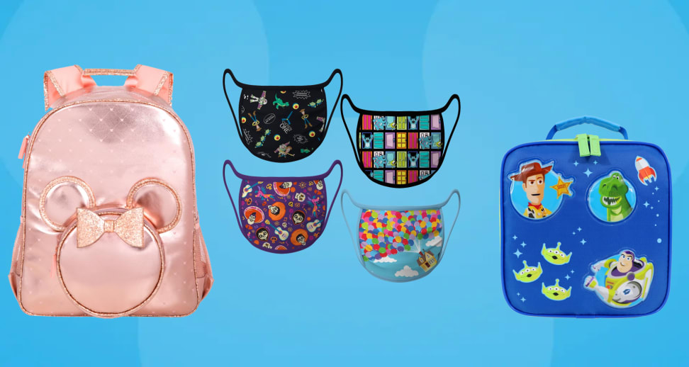 blue Mickey Mouse background with pink backpack, toy story lunchbox and pixar face masks