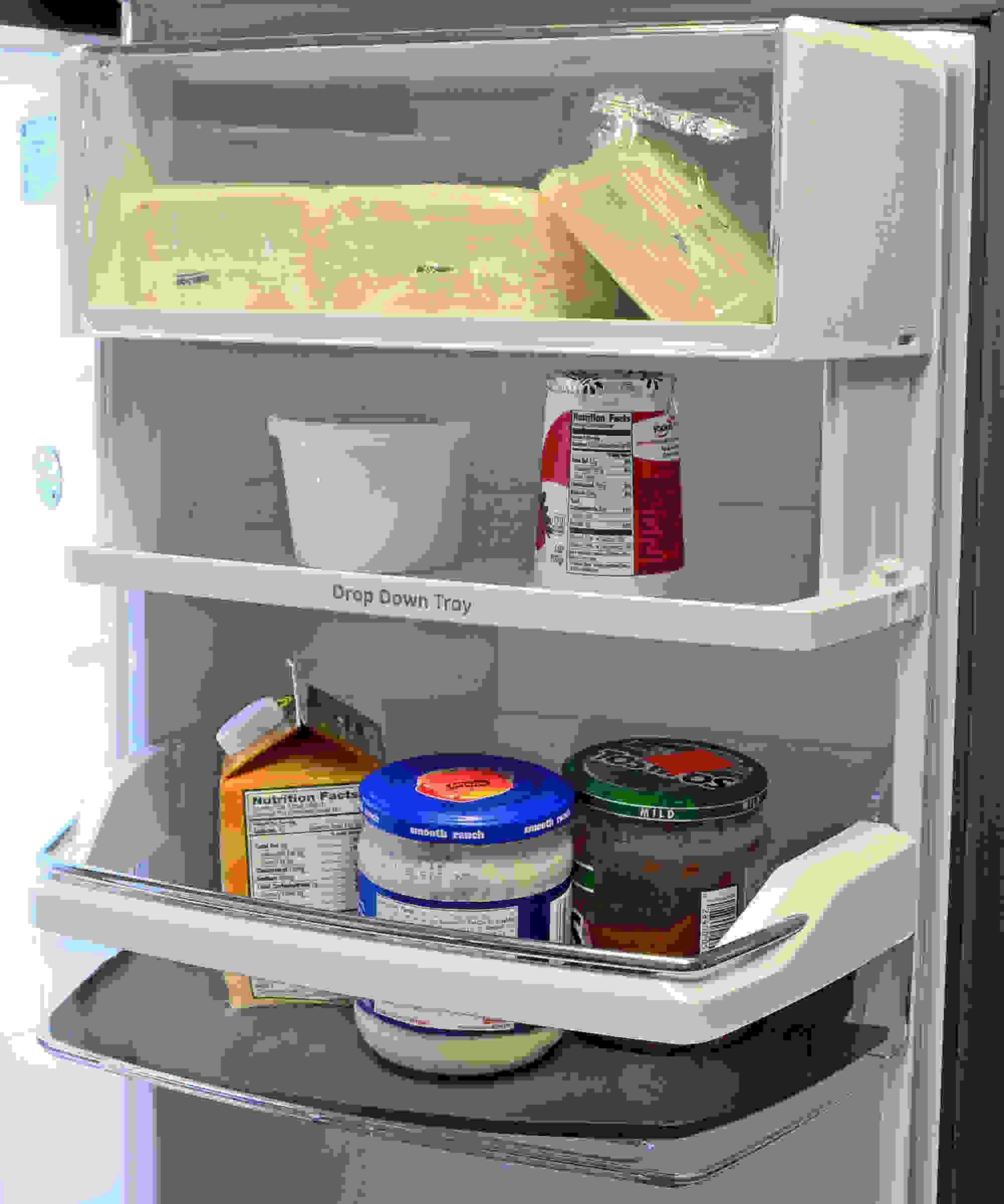 The GE Cafe CFE28TSHSS's drop down tray is great if you plan to store a lot of shorter items on the door.