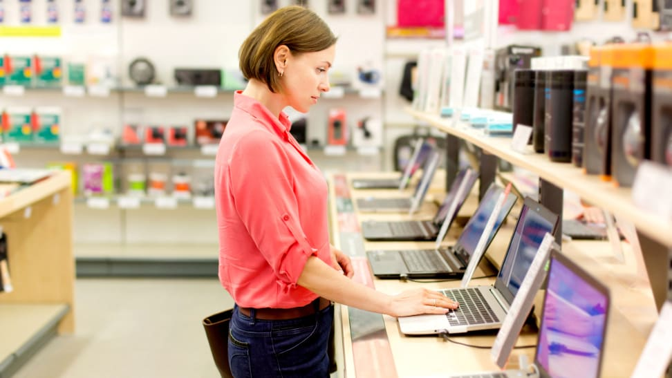 This woman looking at laptops could also be looking for the best things to buy at Staples.