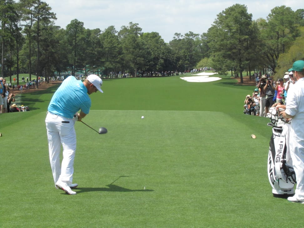 A golfer tees off at the Masters golf tournament