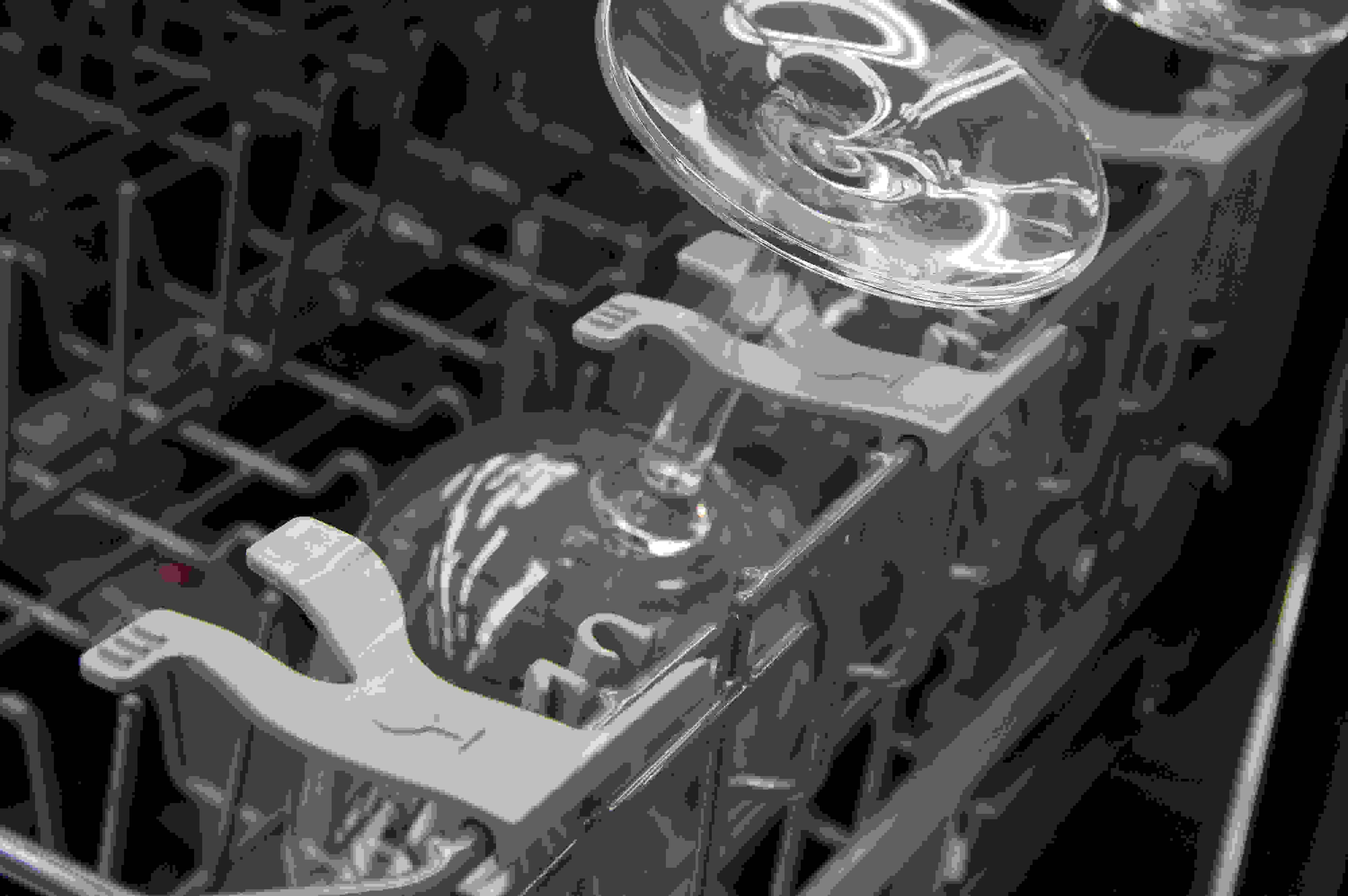 Wine glasses held by the stemware holders