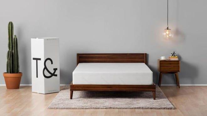 Memory foam mattress in frame in modern bedroom.