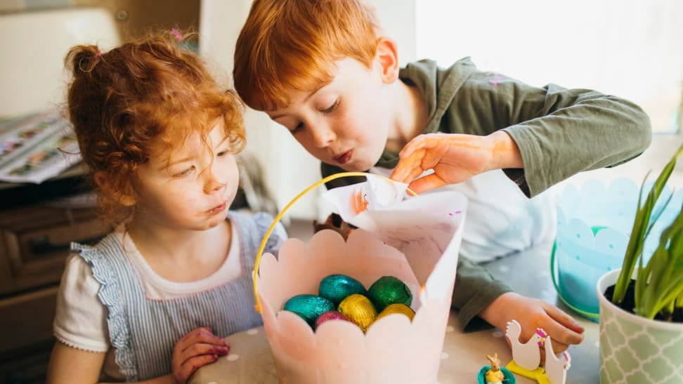 Brother and sister look into an easter basket