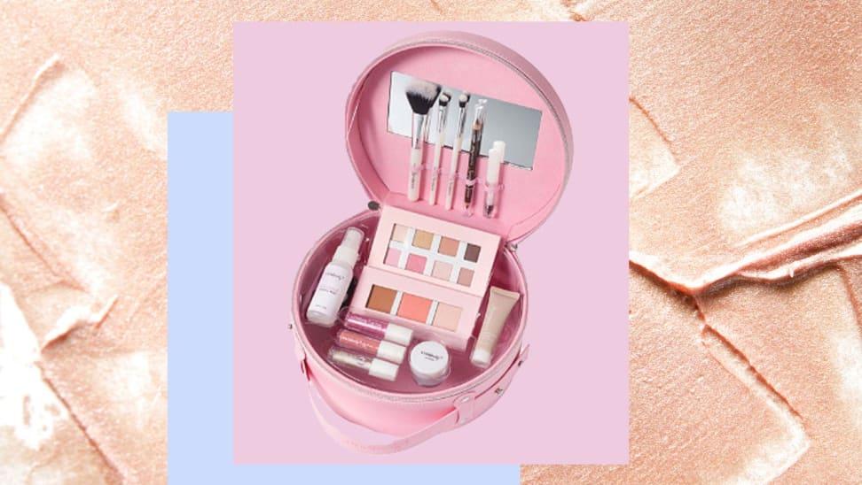 Pink makeup kit against a makeup background