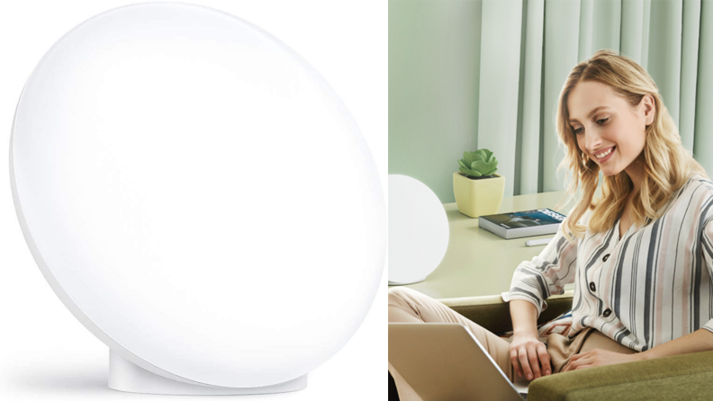 On left, light therapy lamp. On right, woman using laptop computer next to light therapy lamp.