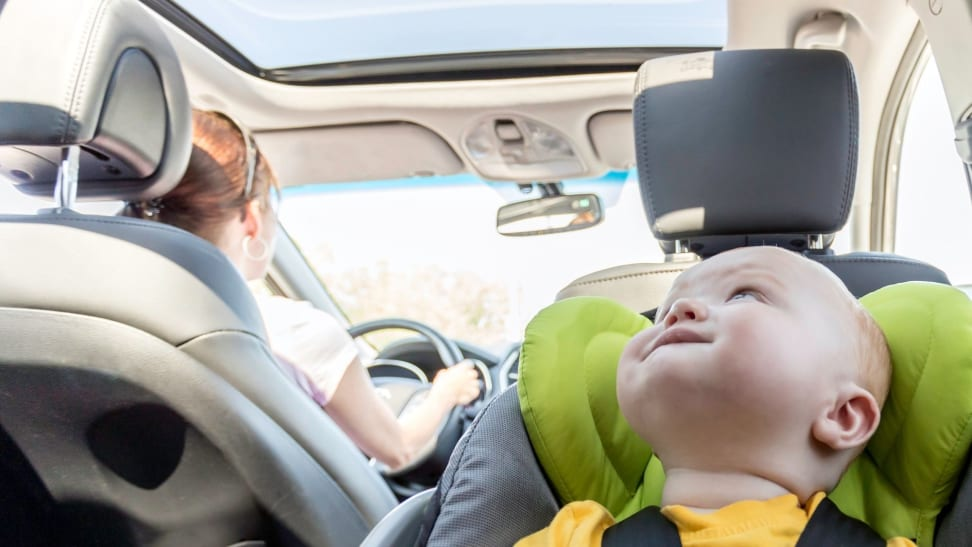Boy in car seat riding in car